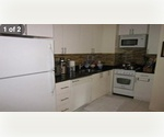Large One Bedroom with Brand New Kitchen in Full Service Building in Upper East Side. Stacked with Amenities!