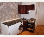 Upper East Side Studio with all modern kitchen, exposed brick, and W/D in the unit!