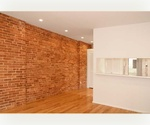 One Bedroom with Wraparound Exposed Brick~Renovated & Close to 4/5/6 Train Lines