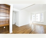 Astonishing 1BR Duplex With Superb Condo Finishes Downtown!